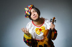 The funny violin clown player in musical concept Royalty Free Stock Photography