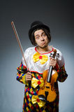 Funny violin clown player in musical concept Royalty Free Stock Photos