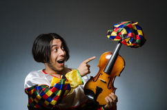 Funny violin clown player in musical concept Royalty Free Stock Photography