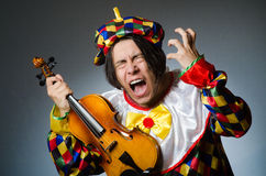 Funny violin clown player in musical concept Royalty Free Stock Photo