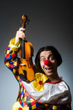 Funny violin clown player in musical concept Stock Images