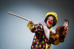 Funny violin clown player in musical concept Stock Image