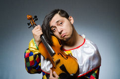 Funny violin clown player in musical concept Stock Photo