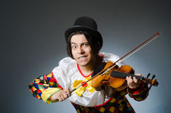 Funny violin clown player in musical concept Royalty Free Stock Images