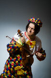 Funny violin clown player in musical concept Royalty Free Stock Image