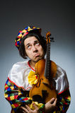 Funny violin clown player in musical concept Stock Photography