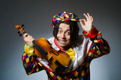 The funny violin clown player in musical concept Stock Image