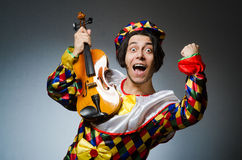 The funny violin clown player in musical concept Royalty Free Stock Images
