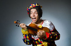 The funny violin clown player in musical concept Royalty Free Stock Photos
