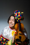 The funny violin clown player in musical concept Royalty Free Stock Photo