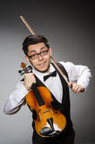 Funny violin player Stock Photo