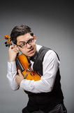 Funny violin player Stock Images