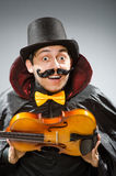 The funny violin player wearing tophat Royalty Free Stock Photography