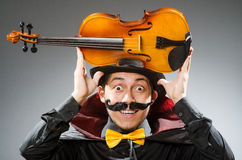 The funny violin player wearing tophat Stock Image