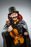 The funny violin player wearing tophat Stock Photos