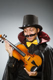 The funny violin player wearing tophat Royalty Free Stock Images