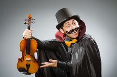 The funny violin player wearing tophat Royalty Free Stock Image