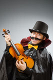 The funny violin player wearing tophat Stock Images