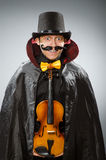 Funny violin player wearing tophat Royalty Free Stock Image