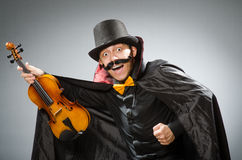 Funny violin player wearing tophat Royalty Free Stock Photo