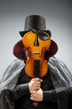 The funny violin player wearing tophat Stock Photo