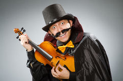 The funny violin player wearing tophat Royalty Free Stock Photo