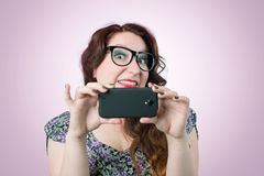 Funny viper girl with a smartphone Stock Images