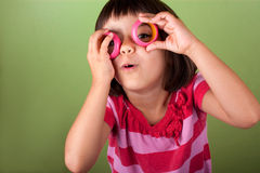 Funny vision. Funny little girl pretending she wears eyeglasses Stock Photos
