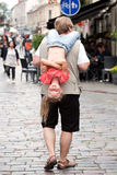 Funny walk. Man carrying on his shoulder funny little girl Stock Photo