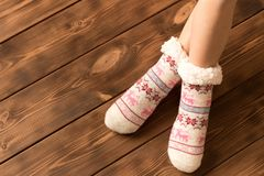 Funny warm socks on the little girl`s feet stock images