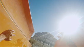 Funny water slides. Quickly to go down, in a frame hands and the sun are visible. POV video. Funny water slides. Quickly to go down, in a frame hands and the sun stock video footage