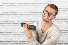 Funny weak man. Tries to lift a weight Stock Photography