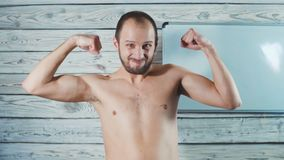 Funny weak sportsman exercising. A THIN MAN SHOWS MUSCLE stock video