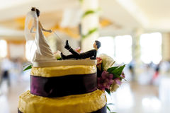 Funny wedding cake docoration, tied groom on bride's leash. Stock Photography
