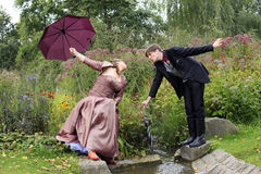Funny wedding couple in autumn at small creek stock photo