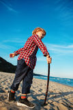 Funny white Caucasian child kid boy playing on ocean sea beach on sunset outdoors Royalty Free Stock Photos