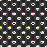 Funny white skulls with bows over dark background. Seamless pattern with white funny skulls over dark background Royalty Free Stock Photos