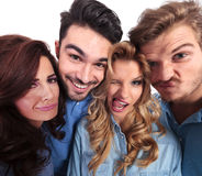Funny wide angle picture of casual people making faces. Funny wide angle picture of casual people fooling around and making faces stock photo