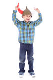 Funny winking young boy with viking helmet royalty free stock photography