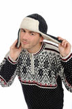 Funny winter man in warm hat and clothes listening Royalty Free Stock Photography