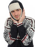 Funny winter man in warm hat and clothes listening Royalty Free Stock Image