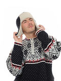 Funny winter man in warm hat and clothes listening Stock Photo