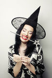 Funny Witch. Young happy woman with canival hat. Royalty Free Stock Photos