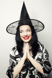 Funny Witch. Young happy woman with canival hat. Royalty Free Stock Images