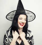 Funny Witch. Young happy woman with canival hat. Stock Images