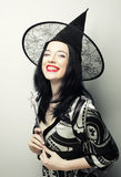 Funny Witch. Young happy woman with canival hat. Royalty Free Stock Image