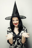 Funny Witch. Young happy woman with canival hat. Stock Photos