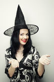 Funny Witch. Young happy woman with canival hat. Stock Photo