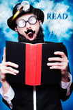 Funny Wizard Reading Magic Book Of Inspiration Royalty Free Stock Photo