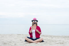 Funny woman on a beach Stock Image